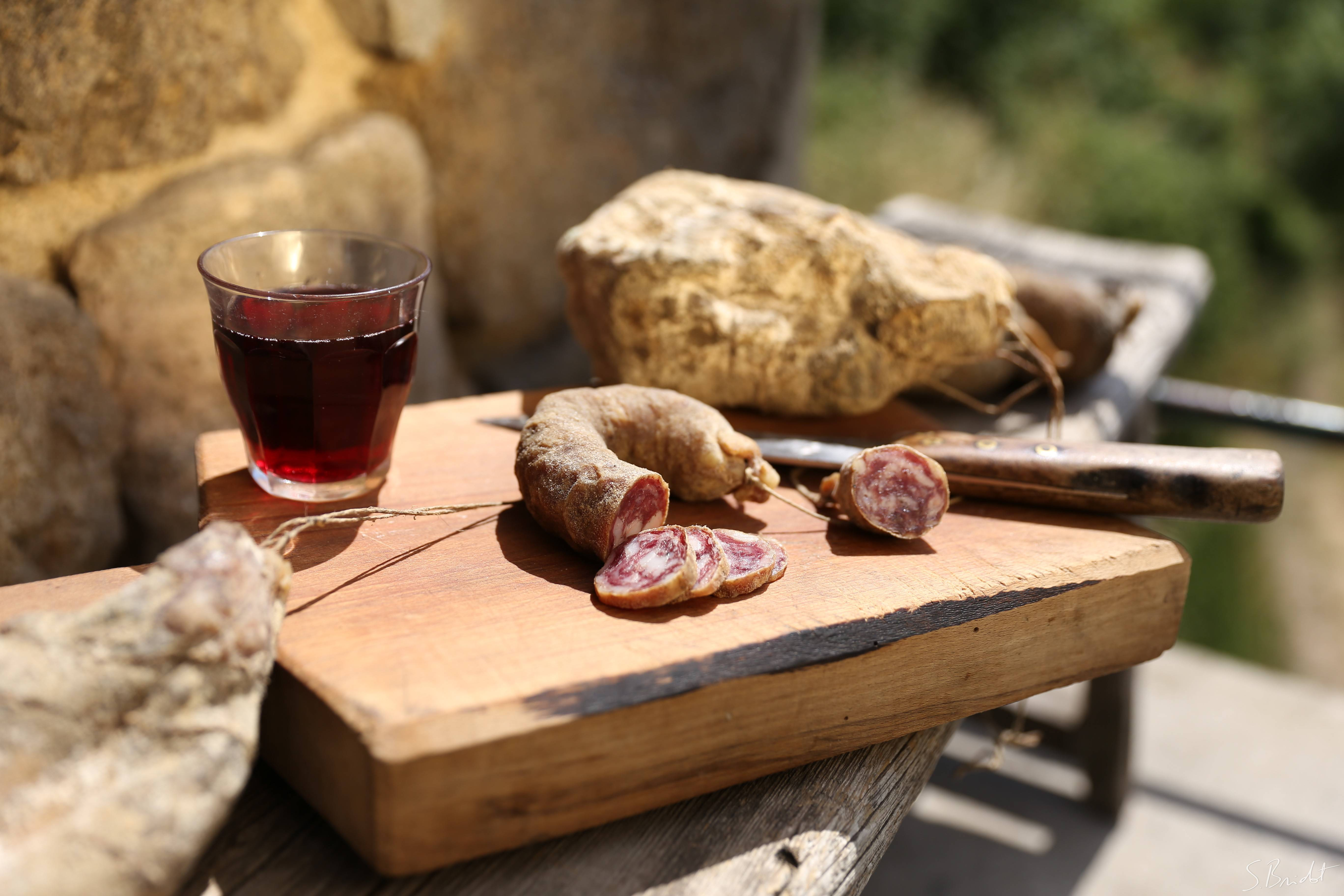 Sausage of Ardeche and glass of Saint Joseph